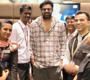 Prabhas surrounded by Air-hostesses at airport