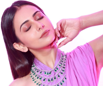 Rakul Preet Singh shines in purple saree